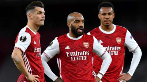 Arsenal's Granit Xhaka, Alexandre Lacazette and Gabriel Magalhaes reacts during their side's Europa League game with Slavia Prague