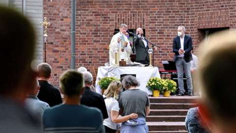 Couples attend a blessing outside a Catholic church in Cologne