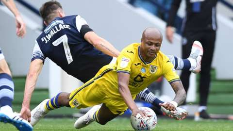 Andre Ayew is tackled by Jed Wallace
