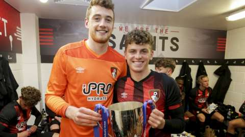 Mark Travers and Gavin Kilkenny celebrate winning the Hampshire Senior Cup for Bournemouth