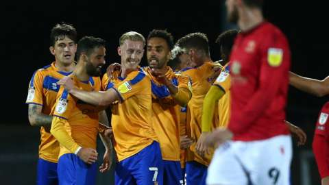 Mansfield celebrate a goal against Morecambe