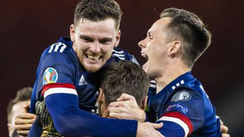 Andy Robertson, David Marshall and Lawrence Shankland celebrate Scotland's shootout win against Israel