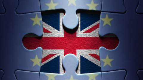 Missing piece from a European jigsaw puzzle revealing the British flag