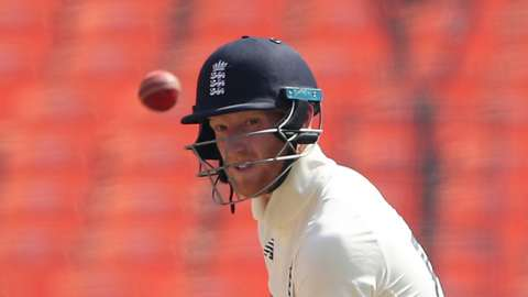 England batsman Ben Stokes watches the ball after playing a shot on day one of the final Test against India