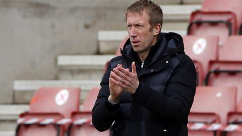 Brighton manager Graham Potter clapping his side from the sidelines