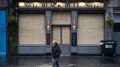 Boarded up pub in lockdown