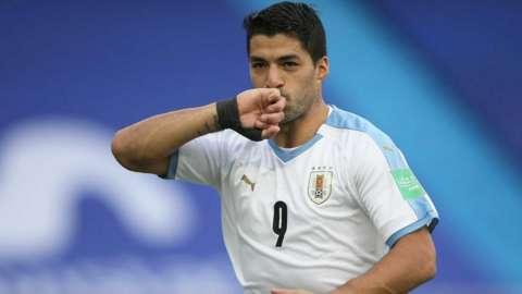 Luis Suarez celebrates scoring a goal