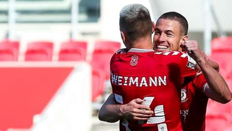 Andreas Weimann celebrates with Tommy Rowe after Rowe scores for Bristol City against Sheffield Wednesday