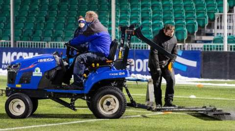 A tractor on the Scotstoun Stadium pitch