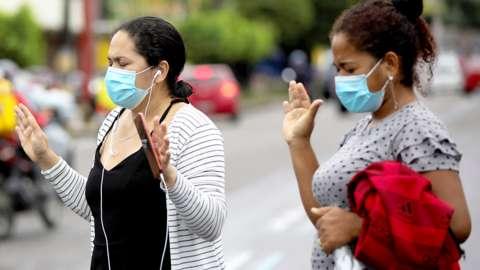 Women in brazil demonstrate outside hospital