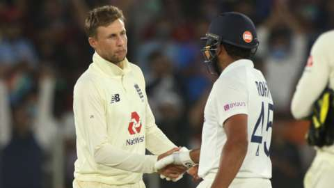 Joe Root shakes hands with Rohit Sharma