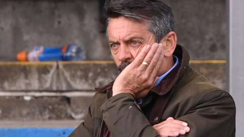 Southend boss Phil Brown watches on