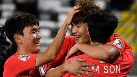Kim Minjae celebrates with Hwang In-Beom and Son Heung-min after scoring a goal for South Korea