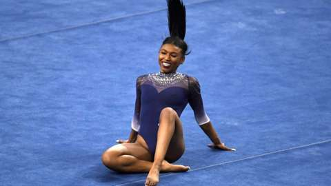UCLA Bruins gymnast Nia Dennis competes in the floor exercise on campus in Los Angeles on January 23, 2021.