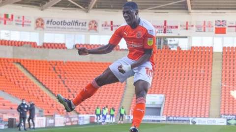 Sullay Kaikai celebrates a goal for Blackpool