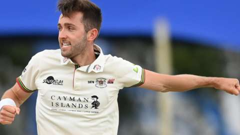 Gloucestershire bowler Matt Taylor celebrates taking a wicket against Middlesex