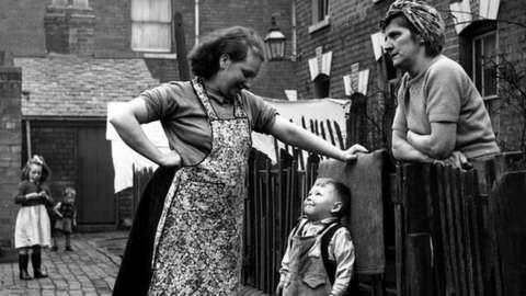 Neighbours talking in the street in Birmingham in 1964