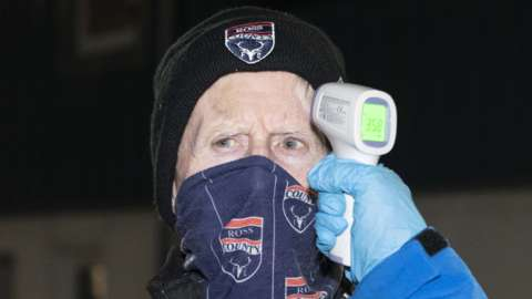 A Ross County has his temperature taken