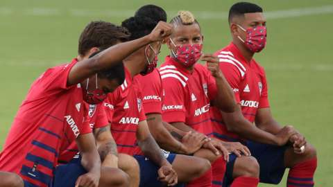 FC Dallas players kneel before their MLS match against Nashville
