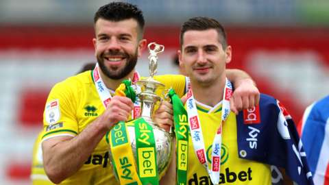 Grant Hanley (left) celebrates with the Championship trophy