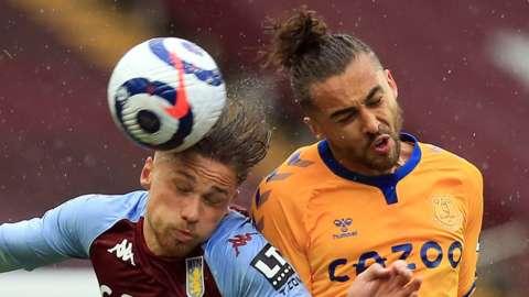 Aston Villa's Matty Cash competes with Everton's Dominic Calvert-Lewin