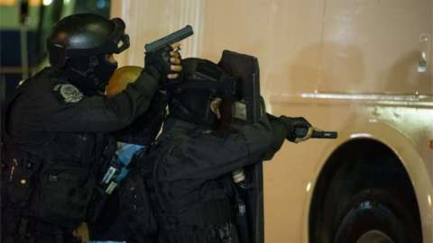 Members of various Brazilian police forces train during a hostage taking drill at the Central Bus station in Rio de Janeiro on early 1 October 2015.