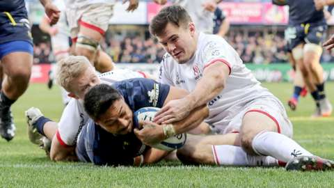 Ulster's Jacob Stockdale fails to prevent Clermont's George Moala scoring a try in the 2019-20 pool game in France