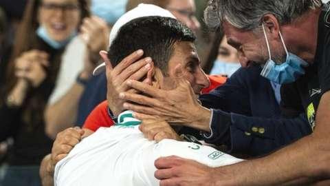 Novak Djokovic celebrates with his team