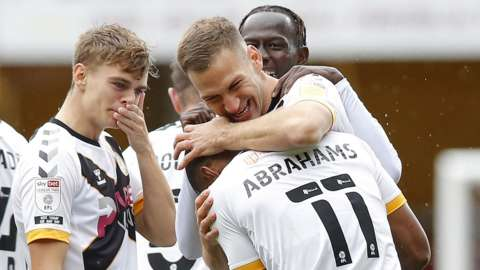 Mickey Demetriou of Newport County celebrates with Tristan Abrahams