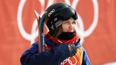 Rowan Cheshire holding her skis at the Pyeongchang Winter Olympics