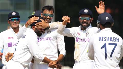 India celebrate after taking wicket against England in Chennai