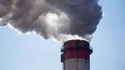 Stock image of smoke rising from the chimney of a coal fired power plant in Poland