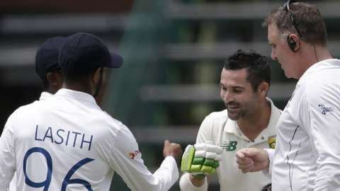 South Africa's Dean Elgar fist pumps the Sri Lanka players at the end of the second Test