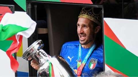 Italian football Captain Giorgio Chiellini steps off bus with trophy