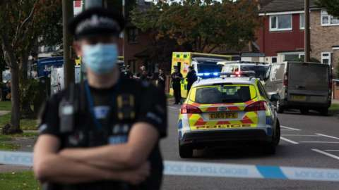 Police officers and ambulance crew attend following the stabbing of UK Conservative MP Sir David Amess