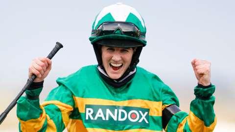 Rachael Blackmore celebrates winning the Randox Grand National