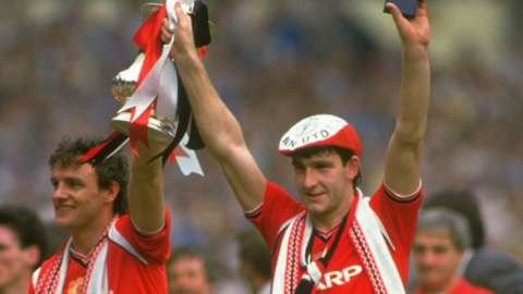 Norman Whiteside hold the FA Cup aloft after the 1985 final