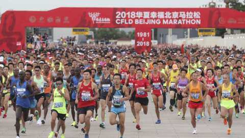 Beijing Marathon participants start running from Tiananmen square on 16 September 2018 in Beijing, China