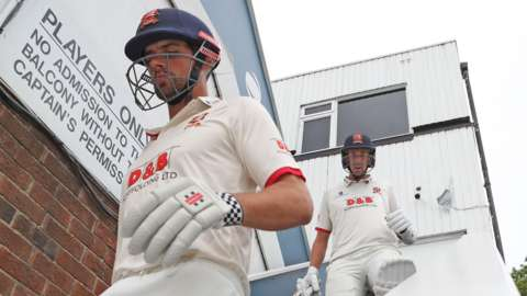 Sir Alastair Cook walks out to bat for Essex