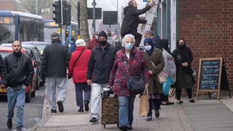 People walking along a Birmingham street
