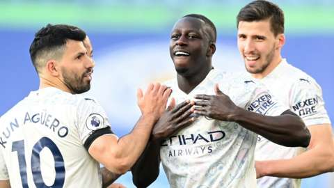 Benjamin Mendy (centre) celebrates scoring for Manchester City against Leicester City