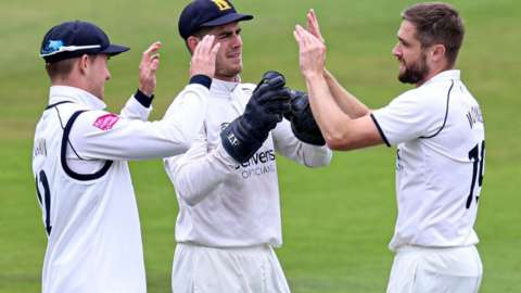 Warwickshire's Chris Woakes celebrated taking the wicket of England team-mate Dawid Malan at Headingley