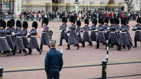 The changing of the guard ceremony outside Buckingham Palace