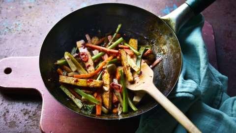 A stir fry in a wok
