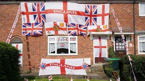 House covered in St George's flags
