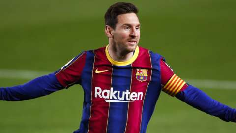 Lionel Messi celebrates scoring for Barcelona against Getafe