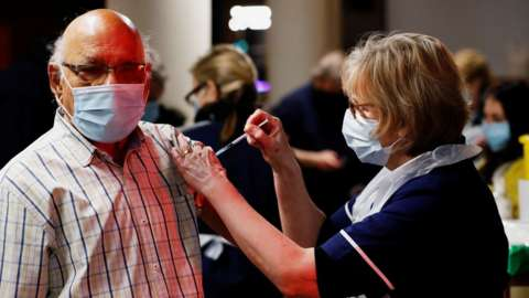 A man in St Albans receives a vaccine dose