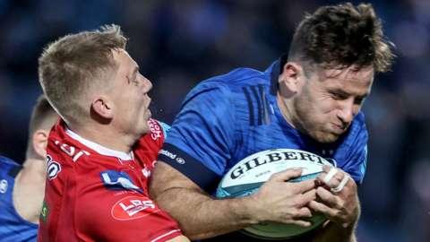 Scarlets back Johnny McNicholl tackles Leinster's Hugo Keenan