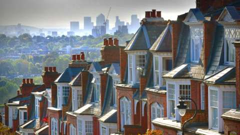 A row of houses in Muswell Hill with the City of London in the background