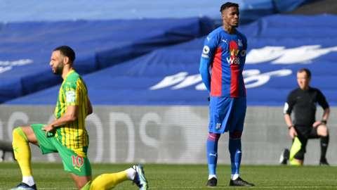 Wilfried Zaha stands at kick-off